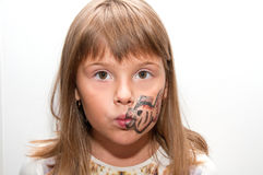 Girl with painted face. Female child with painted fish on her face Royalty Free Stock Image