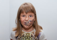 Girl with painted face. Female child with painted fish on her face Royalty Free Stock Images