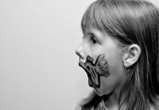 Girl with painted face. With fish print side view black Stock Photos