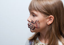 Girl with painted face side view. Girl with painted face with fish print side view Royalty Free Stock Photography