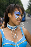 Girl with a painted face & a turquoise costume Royalty Free Stock Images
