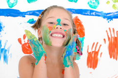 Girl painted with finger paints Royalty Free Stock Photo