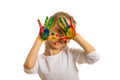 Girl with painted fingers frame her eye. Girl with hands in colorful paints framing her eye isolated on white background royalty free stock images