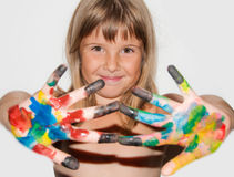 Girl with painted fingers. Teen girl painted fingers in front of her body royalty free stock images