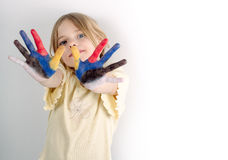 Girl with painted hands Stock Photography