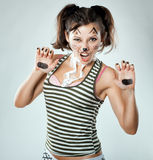 Girl painted like a cat, the picture is  joke. Royalty Free Stock Photos