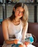 Girl with painted mug Stock Photography