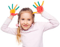 Girl with painted palms on white Stock Photos