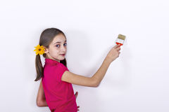 Girl painted wall Stock Images