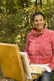 Girl-painter Stock Images