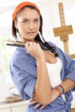 Girl with painter brush Stock Photos
