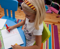 Girl painting. Little girl is painting in her room Royalty Free Stock Image