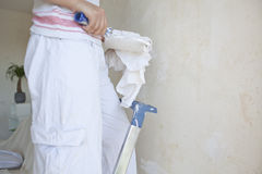 Girl painting apartment. Inside at day time Royalty Free Stock Images