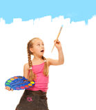 Girl painting with blue paint Royalty Free Stock Photos