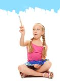 Girl painting with blue paint Royalty Free Stock Images
