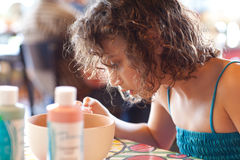 Girl painting a bowl Royalty Free Stock Photo
