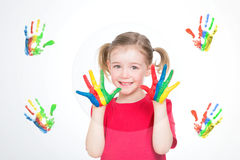 Girl painting colourful handprints Stock Photo