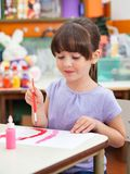 Girl Painting At Desk In Art Class Royalty Free Stock Images