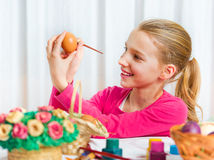 Girl painting an Easter egg Royalty Free Stock Image