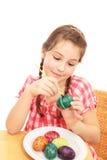 Girl painting Easter Eggs Stock Image