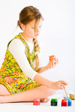 Girl Painting Easter Eggs Stock Image