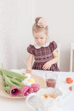 Girl is painting Easter eggs Royalty Free Stock Photos