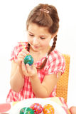 Girl painting egg Stock Photography