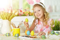 Girl  painting eggs. Little girl painting eggs for Easter holiday Royalty Free Stock Photography