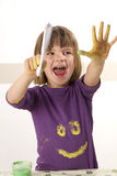 Girl painting with finger paint Royalty Free Stock Photos