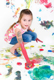 Girl painting with fingercolors Royalty Free Stock Photography