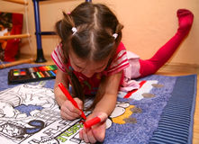 Girl painting on the floor Royalty Free Stock Image