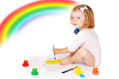 Girl painting on floor Stock Image