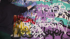 Girl painting graffiti on the wall stock footage