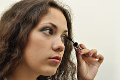 Girl painting her lashes Royalty Free Stock Images