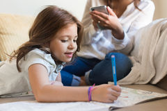 Girl painting with her mom chating Stock Photos