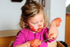 Girl is painting her self Royalty Free Stock Photo