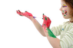 Girl painting herself Stock Photography