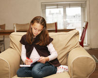 Girl painting at home Stock Photography