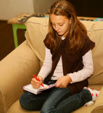 Girl painting at home Royalty Free Stock Image