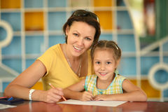 Girl painting with mother Royalty Free Stock Photography