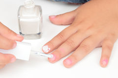 Girl painting nails Royalty Free Stock Photo