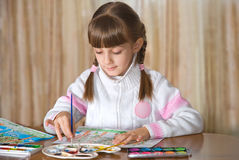 The girl painting a picture. The girl draws picture a paints Royalty Free Stock Photography