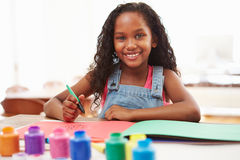 Girl Painting Picture On Table At Home Royalty Free Stock Images