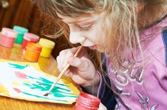 Girl painting in preschool Royalty Free Stock Photo