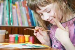 Girl painting in preschool Stock Images