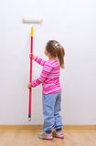 Girl with painting roller Royalty Free Stock Image