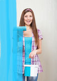 Girl painting the screen royalty free stock photography