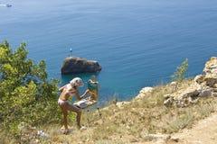 Girl painting sea Royalty Free Stock Photo