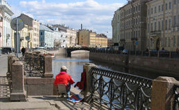 Girl painting in St Petersburg. Student girl painting in St Petersburg Stock Image
