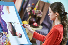 Girl painting still life by oil paint in studio Stock Photos